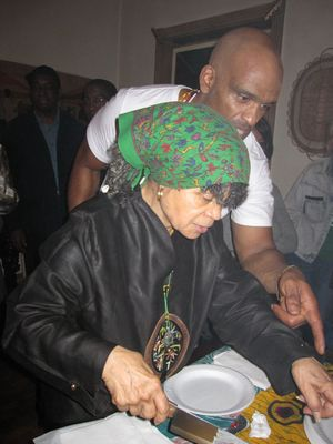 Sonia Sanchez cuts her birthday cake.