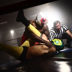 Bigstock_Masked_wrestlers_and_referee_i_24830204