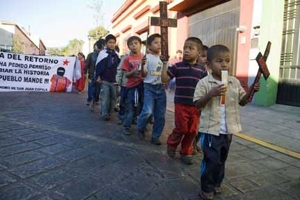 Indigenous Triqui children march through the streets of Oaxaca on December 19, 2011, to protest a wave of killihngs in their home community of San Juan Copala.