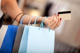 Bigstock-Woman-shopping-and-paying-with-25134428