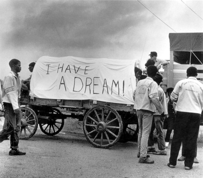 A mule train leaves for Washington during the May 1968 Poor People's March in this photograph by Ernest Withers.