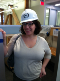 Alyssa Hassan, Senior Marketing Manager at Beacon Press, tours the new building during construction.