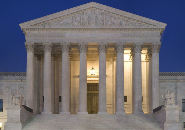 Supreme Court Facade at Dusk (via Wikimedia Commons)