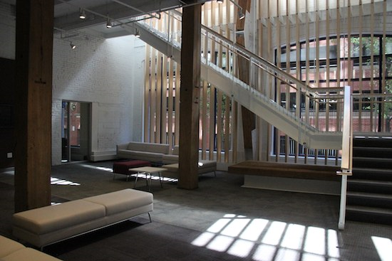 The reception area and grand stair at the UUA's new headquarters at 24 Farnsworth Street (© Dea Brayden/UUA)