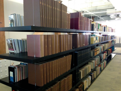 Floating bookshelves make a modern new home for Beacon's historic library.