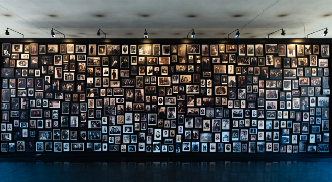 Auschwitz Birkenau Wall of Remembrance, by Nick Moulds (via Creative Commons)