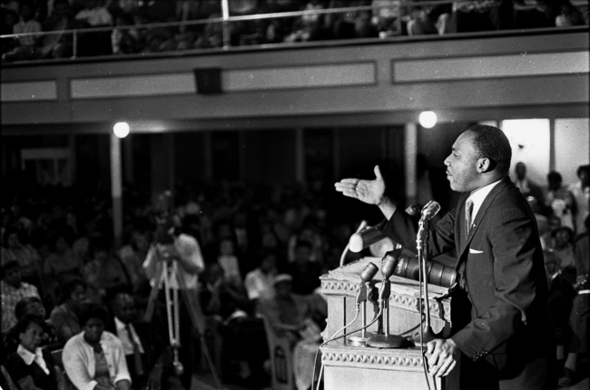"Dr. King speaking during ""phase one"" of  the civil rights movement at the 16th Street Baptist Church in Birmingham, Alabama, sometime before Ku Klux Klan members bombed it on September 15, 1963.  (Joe Chapman)"