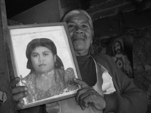 Esperanza, holding a photo of herself as a young woman, 2006