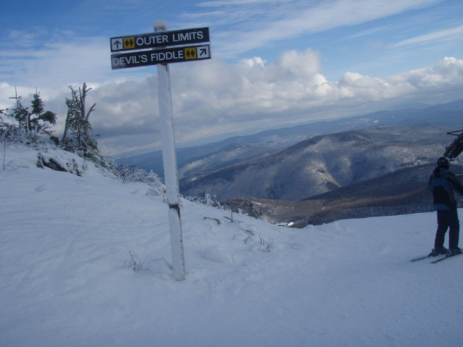 A sign pointing to Devil's Fiddle and Outer Limits, some of the steepest trails at Killington