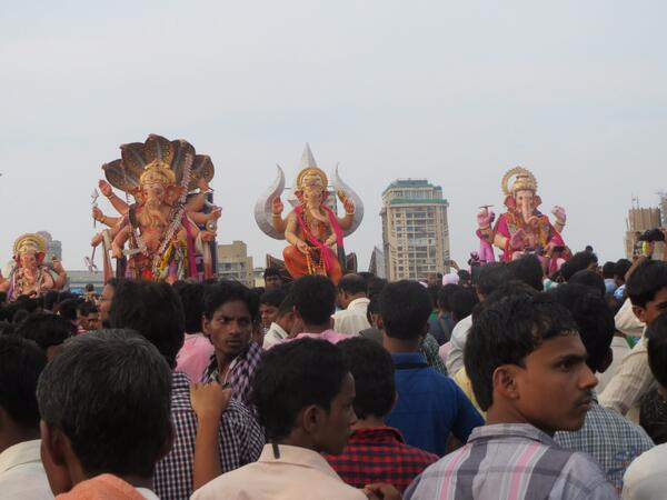 Giant Ganesha statues hit the beach in Mumbai, heading into the sea