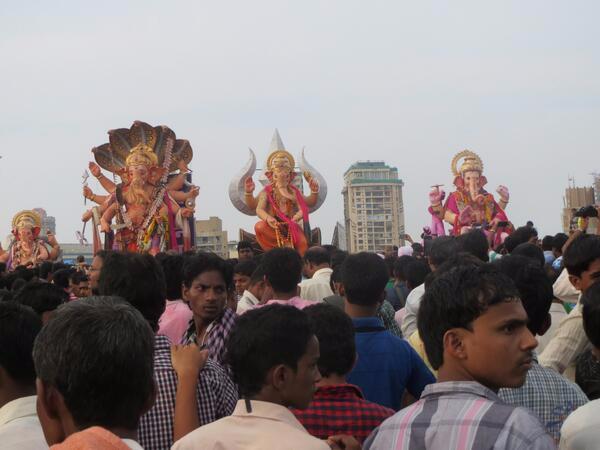 Giant Ganesha statues hit the beach in Mumbai, heading into the sea