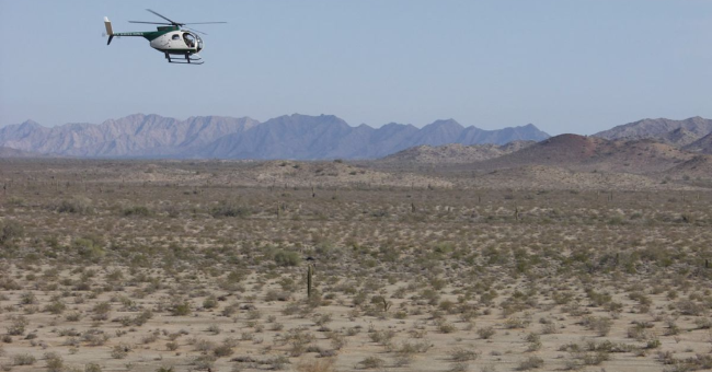 US Border Patrol helicopter over the Sonoran Desert