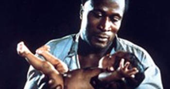 """John Amos as Kunta Kinte in """"Roots"""" blessing his baby daughter Kizzy in the tradition of his Mandinka ancestors"""