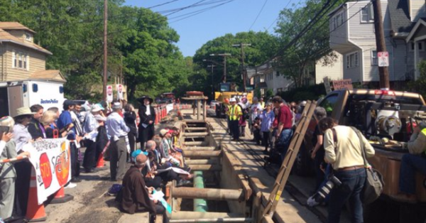 Sixteen interfaith clergy about to be arrested to #StopSpectra