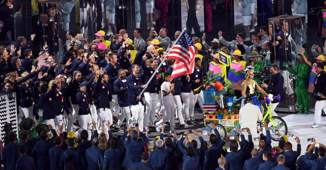 Michael Phelps carries American flag during 2016 Olympic Games