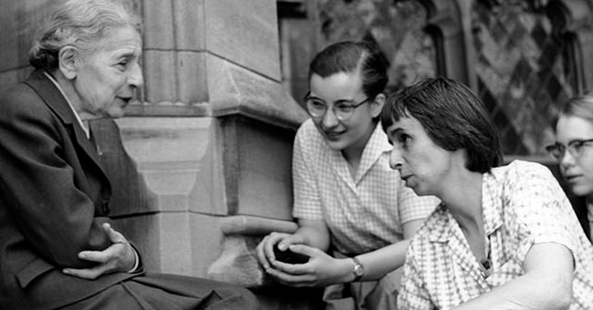 Lise Meitner with students (Sue Jones Swisher, Rosalie Hoyt and Danna Pearson McDonough) on the steps of the chemistry building at Bryn Mawr College. Courtesy of Bryn Mawr College. (April 1959)