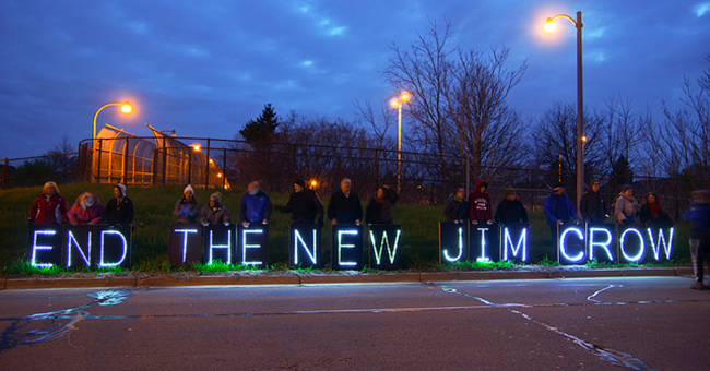 The Overpass Light Brigade in Milwaukee, WI, protesting against voucher programs and charter schools