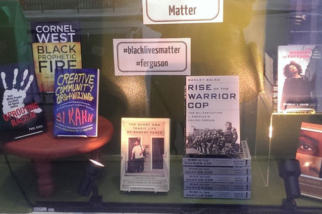 A window at Left Bank Books in St. Louis displays titles in their Black Lives Matter Reading List