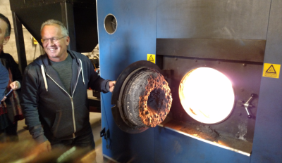 Søren Hermansen shows visitors the straw-fired furnace at Samsø's Ballen-Brundby district heating plant.