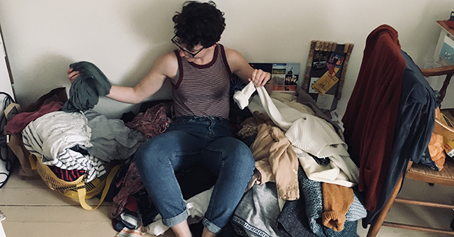 Ayla Zuraw-Friedland sorting her clothes piles