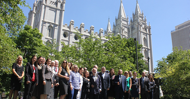 Presenters, including author Linda K. Wertheimer, from the Brigham Young University's Religious Freedom Annual Review conference and hosts from the Mormon church stand in front of the Salt Lake Temple.