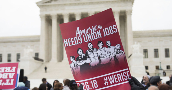 Demonstrators outside the US Supreme Court during arguments in the union fees case Janus v. AFSCME, on February 26, 2018.