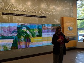 A guide from the Mormon history museum begins a tour for Wertheimer and other presenters at a religious freedom conference.