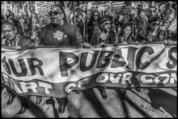 Keith Brown, president of the Oakland Education Association, and other teachers lead a march through downtown Oakland.