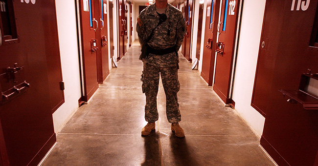 A soldier stands guard on a cell block inside Camp Five at Guantánamo Bay.