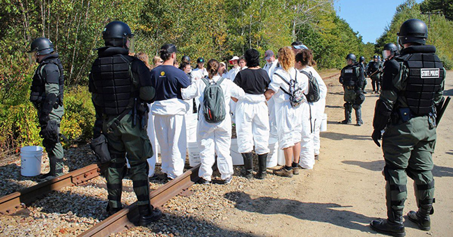 New Hampshire State Police in full riot gear arrest peaceful protesters with the grassroots #NoCoalNoGas campaign at Merrimack Station in Bow, NH, the last major coal-fired power plant in New England, on September 28, 2019. Sixty-seven were arrested, with hundreds more supporting.