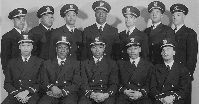 Recently commissioned black officers: front row (left to right): Ensigns George Cooper, Graham Martin, Jesse Arbor, John Reagan, and Reginald Goodwin; back row (left to right): Dennis Nelson, Phillip Barnes, Sam Barnes, Dalton Baugh, James Hair, Frank Sublett, and Warrant Officer Charles Lear. William Sylvester White was commissioned but is not pictured in this photo. February 1944.