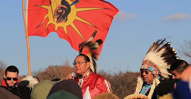 Beyond NoDAPL March on Washington, DC. Native American speaker with his father and a drum. December 8, 2016.
